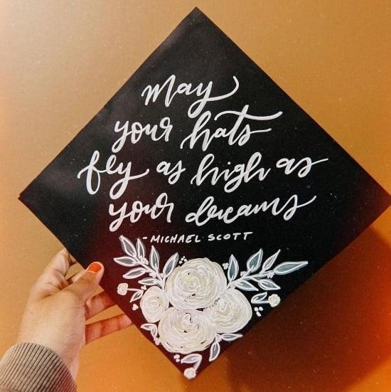 black graduation cap with michael scott quote in handwritten script